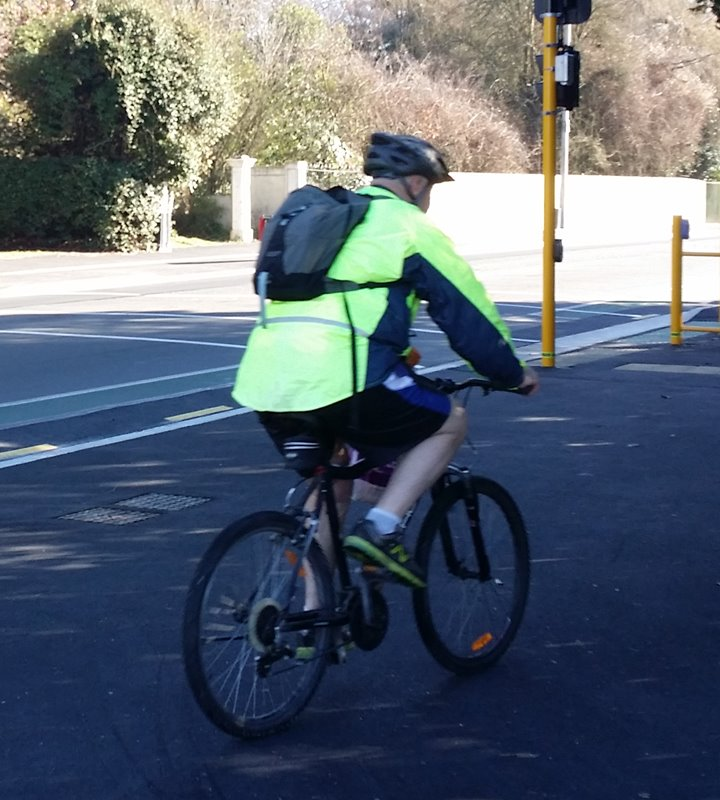 Person cycling in hi-vis